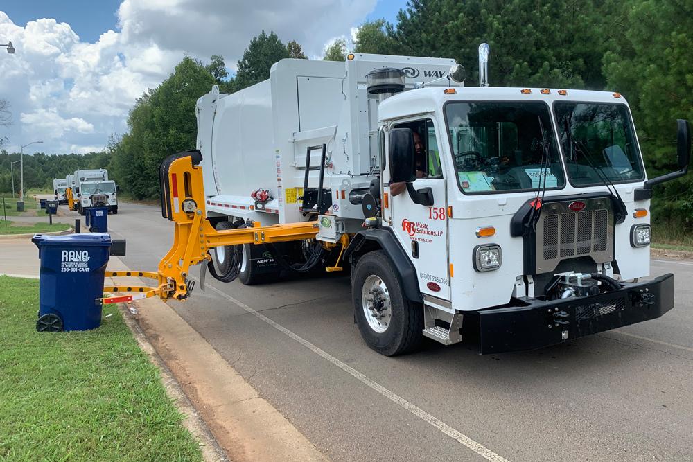 waste disposal trucks sideload